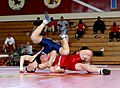 US Navy 040307-M-2270C-006 At the 2004 Armed Forces Wrestling Championship held at Archbishop Rummel High School, New Orleans, La., U.S. Marine Corps Lance Cpl. Carson Bernard, in red, battles his Navy opponent Damage Controlma.jpg