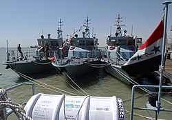 US Navy 040612-N-0401E-005 Iraqi Coastal Defense Force (ICDF) Patrol Crafts are prepared for the official opening of the ICDF base in Umm Qasr, Iraq.jpg