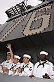 US Navy 040723-N-0696M-049 Sailors aboard USS Ronald Reagan (CVN 76) scan the pier for family and friends following their arrival at their new homeport at Naval Air Station North Island, San Diego.jpg