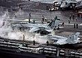 US Navy 041020-N-6278K-190 An F-A-18C Hornet and an F-14B Tomcat standby to launch from the Nimitz-class aircraft carrier USS George Washington (CVN 73).jpg