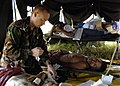 US Navy 050106-N-6817C-335 A U.S. Naval medical officer treats injured Indonesian patients flown into Aceh, Sumatra, Indonesia from devastated villages.jpg