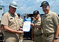 US Navy 050304-N-4473C-001 Commander, Submarine Force U.S. Pacific Fleet, Rear Adm. Paul Sullivan, left, presents the Meritorious Unit Commendation to Commanding Officer, USS La Jolla (SSN 701), Cmdr. Brian Howes.jpg