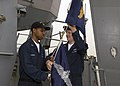 US Navy 060516-N-2385R-037 Quartermaster 3rd Class Carrin Johnson, left, and Quartermaster 2nd Class Jason Bauer, right, raise the Enlisted Surface Warfare Specialist (ESWS) Pennant.jpg