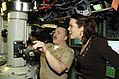 US Navy 070206-N-8467N-001 Cmdr. Daniel Christofferson, commanding officer of the fast attack submarine USS Connecticut (SSN 22) shows Miss Connecticut 2006 Heidi Voight the ship's periscope during a tour of the boat.jpg