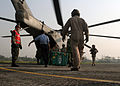 US Navy 071128-M-3095K-027 Marines with the 22nd Marine Expeditionary Unit (MEU) (Special Operations Capable) aid with the loading of care packages onto a CH-53E Super Stallion transport helicopter on Barisal Airfield in southe.jpg