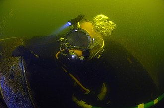 United States Navy Reserve - Navy Reserve Navy Diver Seaman Jesse Kole, assigned to Naval Experimental Diving Unit, does an inspection dive of the interior of the wreck of the former Russian submarine Juliett 484.