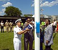 US Navy 080714-N-1232M-278 Capt. David Schnell,Leon Rockingham Jr.,a third grade student at Forrestal School, and Dr. Cassandra Brooks attached the American Flag to the lanyards.jpg