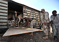 US Navy 081011-F-5009P-162 Members of Naval Mobile Construction Battalion (NMCB) 4 construct a ramp on a derailed train boxcar.jpg