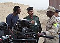 US Navy 090416-N-4141S-031 Engineman 1st Class Mervin Williams and deputy commanding general of the 7th Iraqi Army Division, inspect small-river craft engines at Al Asad Air Base, Iraq.jpg