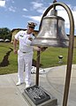 US Navy 090501-N-0995C-039 Lt. Cmdr. Jay Gulley, officer-in-charge of the U.S. Naval Ammunition Depot, Oahu, rings a bell recovered from the aircraft carrier USS Hornet (CV 8) that was dedicated to the command for its 75th anni.jpg