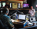 US Navy 090527-N-7375S-008 Capt. Leo Falardeau talks live in Rochester on syndicated radio station WXFX 95.1 during a Rochester Navy Week interview. Falardeau, originally from the Rochester area, is in town supporting the Roch.jpg