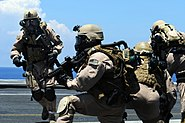 US Navy 090612-N-3659B-122 Members of Explosive Ordnance Disposal Mobile Unit (EODMU) 11, Platoon 0-2, take their positions on the flight deck of the aircraft carrier USS Ronald Reagan (CVN 76) during a fast-roping exercise
