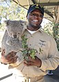 US Navy 090705-N-4015L-201 Chief Storekeeper Jerome Meyers poses for a photo with a koala during a community service project at the Cohunu Koala Park.jpg