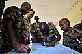 US Navy 090708-N-0506A-019 Lt. Cmdr. Brian Morgan, officer in charge of Maritime Civil Affairs Unit-Horn of Africa, watches Rwandan Defense Forces soldiers from the 59th Infantry Battalion practice mission planning skills.jpg
