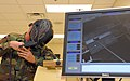 US Navy 090824-N-6272M-001 Steel Worker 1st Class Josh Eichelberger demonstrates the virtual welder system at Naval Construction Battalion Center.jpg
