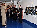 US Navy 091204-N-8848T-790 Chief Boatswain's Mate Donald Walker explains a fire fighting station aboard simulator USS Trayer (BST 21).jpg