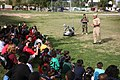 US Navy 100324-N-3271W-204 Members of Explosive Ordnance Disposal Mobile Unit (EODMU) 3, Det. China Lake demonstrate a remote-controlled robot used to investigate and handle explosive devices to children at Tri-City West Boys a.jpg