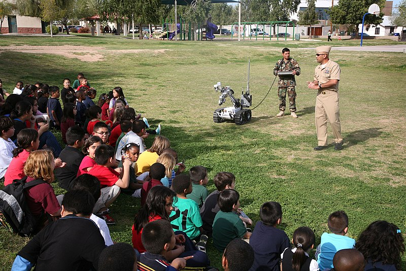 File:US Navy 100324-N-3271W-204 Members of Explosive Ordnance Disposal Mobile Unit (EODMU) 3, Det. China Lake demonstrate a remote-controlled robot used to investigate and handle explosive devices to children at Tri-City West Boys a.jpg