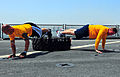 US Navy 100830-N-7948R-454 Operations Specialist 2nd Class Ernest Delacruz, left, and Cryptologic Technician (Technical) 1st Class Jared Pollack perform inverted push ups on the flight deck of the amphibious dock landing ship U.jpg