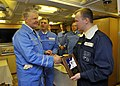 US Navy 110415-N-ZB612-208 Chief of Naval Operations (CNO) Adm. Gary Roughead presents a CNO plaque to the commanding officer of the Russian Federa.jpg