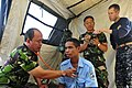 US Navy 110619-N-ZZ999-011 Maj. I Gede Putu Arsana, from the Indonesia army, examines a patient as Lt. Cmdr. Dylan Wessman helps Maj. Faisal Faisal.jpg
