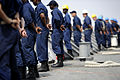 US Navy 110701-N-TY225-010 Sailors assigned to the guided-missile cruiser USS Anzio (CG 68) man the rails as the ship gets underway.jpg