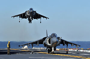 US Navy 120119-N-UM734-730 Two AV-8B Harriers from Marine Attack Squadron (VMA) 542 conduct flight operations aboard the amphibious assault ship US.jpg