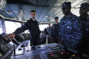 US Navy 120202-N-IZ292-154 Royal Moroccan Naval Ensign Nabil Elkorchi gives a briefing to Sailors from the guided-missile frigate USS Simpson (FFG.jpg