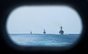 US Navy 120202-N-OY799-048 The Arleigh Burke-class guided-missile destroyers USS Kidd (DDG 100), USS Pinckney (DDG 93), and USS Dewey (DDG 105) tra.jpg