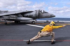 US Navy 120203-N-UM734-145 Chief Aviation Boatswain's Mate (Handling) Antonio Wright, from Charlotte, N.C., directs an AV-8B Harrier on the flight.jpg