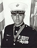 A black-and-white photo of the upper torso of Jay Vargas wearing his military dress uniform with hat and medals