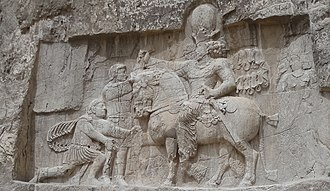 Persian people - A bas-relief at Naqsh-e Rustam, depicting the victory of Sasanian ruler Shapur I over Roman ruler Valerian and Philip the Arab.