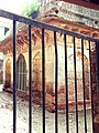 View of Tomb of Jani Khan through iron grid.jpg