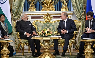 Suit (clothing) - Narendra Modi, Prime Minister of India, and Vladimir Putin, President of Russia, in business suits. Note that Modi is wearing a Nehru jacket with Mandarin collar, a commonplace in India, while Putin's jacket features notch lapels, more common in the Western world.