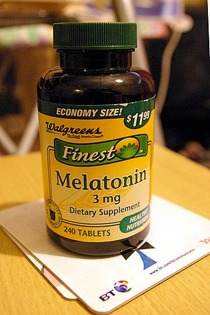 Melatonin - A bottle of melatonin tablets:  additionally, melatonin is available in timed-release and in liquid forms.