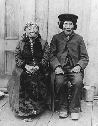 """Duwamish people - Duwamish man and woman, Old Tom and Madeline, Portage Bay, Seattle, c 1904. """"Old Tom"""" is almost certainly Chudups John."""