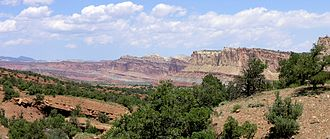 Geology of the Capitol Reef area - The Waterpocket Fold is the major geographic feature in the area of the park. This view is from above Capitol Reef Scenic Drive looking back at the west face of the broken and eroded fold.