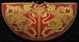 Kermes (dye) - The Coronation Mantle of Roger II of Sicily, silk dyed with kermes and embroidered with gold thread and pearls.  Royal Workshop, Palermo, Sicily, 1133–34. Kunsthistorisches Museum, Vienna.
