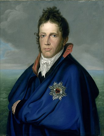 William Frederick, Prince of Orange in c. 1805-1810 Willem Frederik (1772-1843), erfprins van Oranje-Nassau. Later koning Willem I. Genaamd 'Het mantelportret' Rijksmuseum SK-A-4113.jpeg