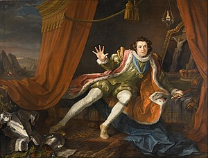Oil painting of the actor Garrick dressed as a Richard III, sitting on a curtained bed with an attitude of despair. At his feet is a set of armor and behind him is a crucifix.
