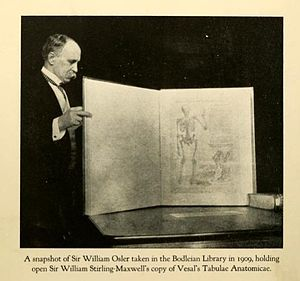 William Osler - Osler in 1909, at the Bodleian Library, Oxford, holding Sir William Stirling Maxwell's copy of Vesalius's Tabulae Anotomicae