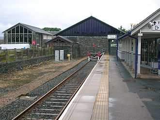 Windermere, Cumbria (town) - Windermere railway station in 2008. The Booths supermarket in the background has been designed to mimic the former trainshed and also incorporates the frontage of the original station