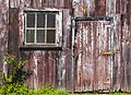Window and door on weathered garage wall.jpg