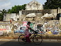 Woman Cycles Past War Ruined Building, Jaffna.jpg