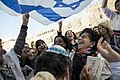 Women of the Wall celebrating with the flag of Israel.jpg
