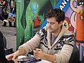 WonderCon 2012 - Joshua Jackson of Fringe signs the Fringe comic he wrote (7019607871).jpg