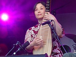 Wu Man performing at WOMAD in 2011.