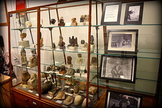 Petrie Museum of Egyptian Archaeology - Display case at entrance to the Petrie, with figurines and statuettes.