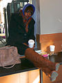 Young woman with brown boots and coffee taking a break Inauguration 2013.jpg