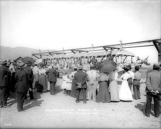 """Fawkes' Folly"" being displayed in front of a large crowd ""Fawkes' Folly"", aerial trolley designed by J.W. Fawkes in Burbank and adorned with flags and decorations, 1907-1910(%3F) (CHS-5015).jpg"